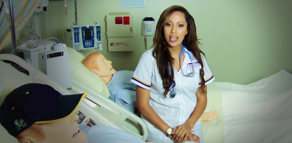 Nursing student with simulation dummy