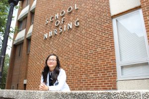 Lisa Yang outside the Moore Building
