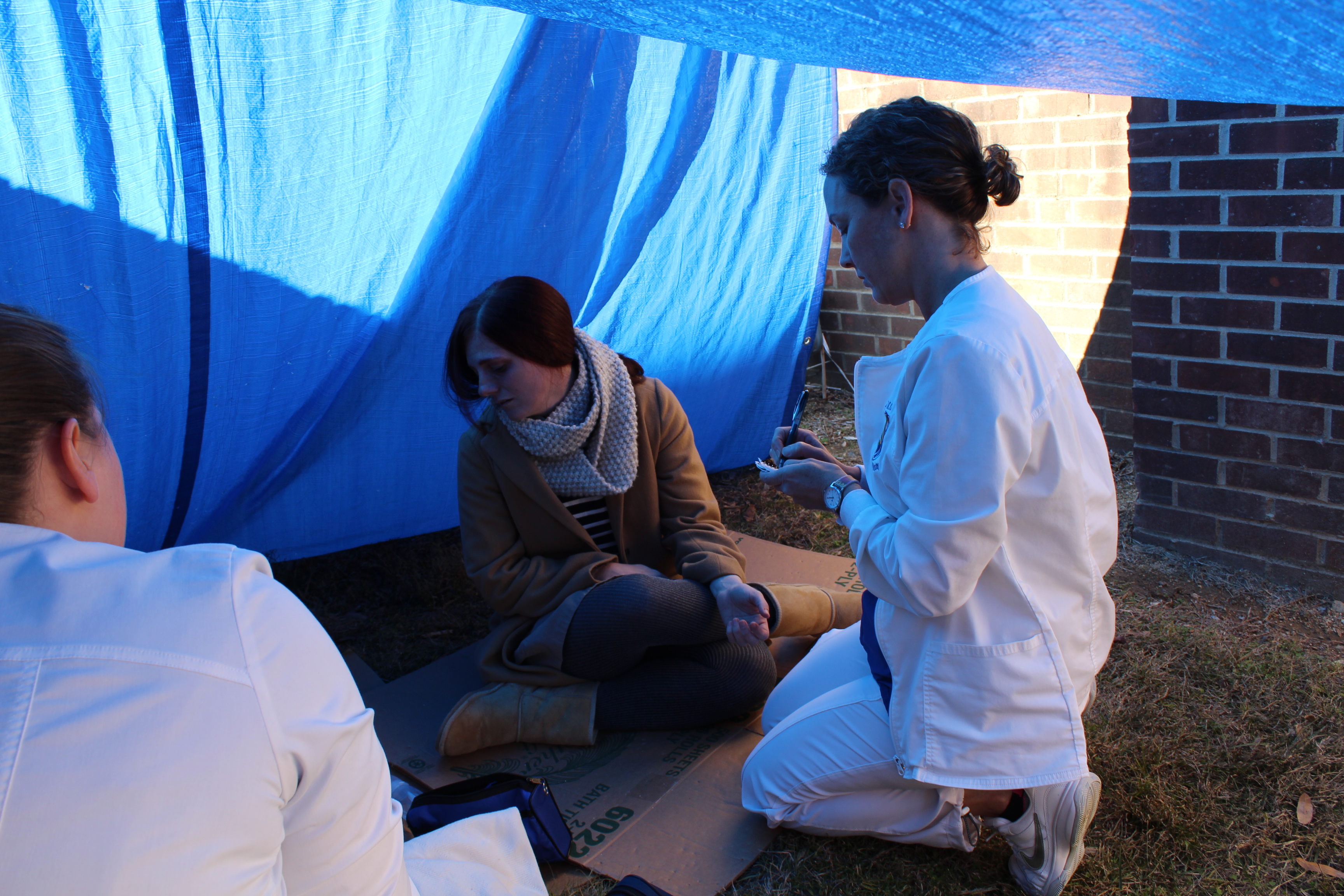 Nursing students work in a homeless simulation