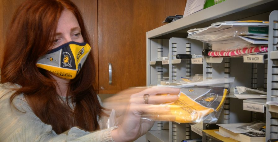 UNCG nursing staff member in a face mask
