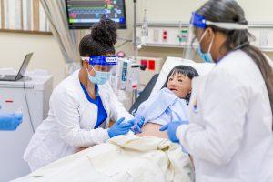 Nursing students in a sim lab.