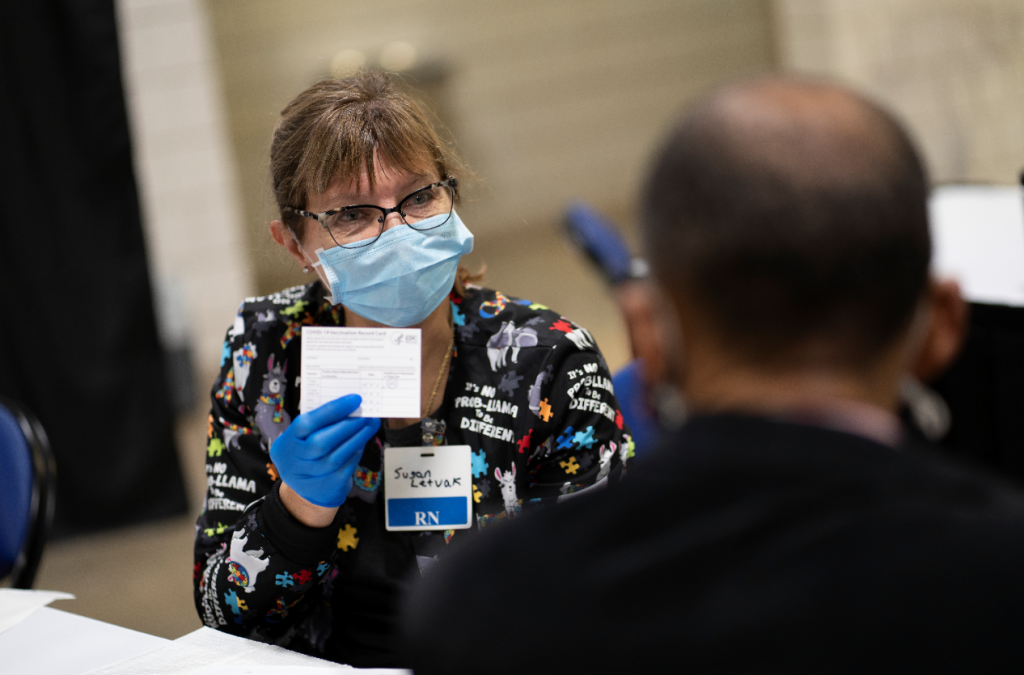 Faculty member Dr. Susan Letvak volunteering at a coronavirus vaccine clinic.